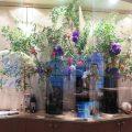 テーマ「初秋」ソケイ、アセビ、ヤマゴボウ、トルコキキョウ(紫)、ケイトウ(オレンジ)、パンパスグラス